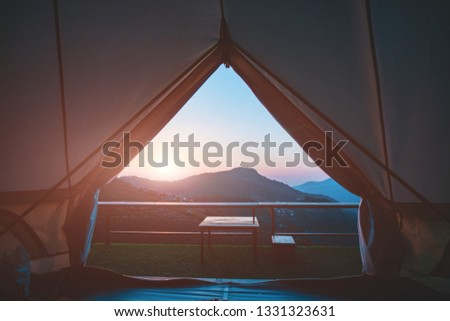 Canvas tent look from inside to see natural view in the morning.Camping with rural scene morning landscape. #1331323631