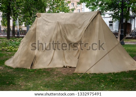 Canvas tent set up in the middle of city #1332975491