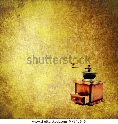 canvas texture old fashioned coffee mill on grunge fabric background with copy space