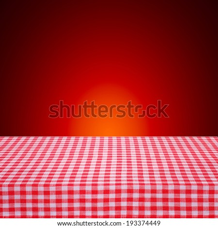Canvas texture or background on the table. Red checked tablecloth view from top. Empty tablecloth for product montage. Free space for your text