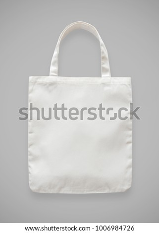 Canvas tote bag mockup blank white eco shopping sack template made of fabric cloth isolated on grey background (clipping path) for bagging mock-up design