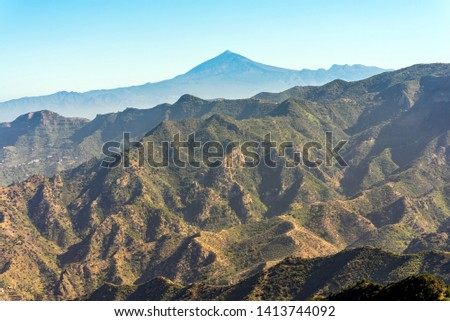 Canyon and jagged mountain range of Vallehermoso what means the beautiful valley in english. In the back, the Pico del Teide on Tenerife