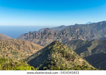 Canyon and jagged mountain range of Vallehermoso what means the beautiful valley in english. View to the Roque Cano, a famous volcanic neck on the north side of La Gomera