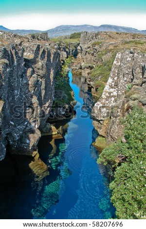 Canyon filled with hot water  at Pingvellir, Iceland