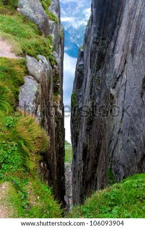 Canyon on the mountain Kjerag, Norway - stock photo