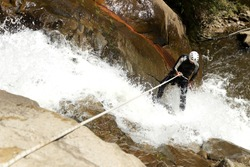 canyon rock adventure waterfall recreational climbing extreme descending canyoning adult male descending an ecuadorian waterfall in a correct position canyon rock adventure waterfall recreational clim