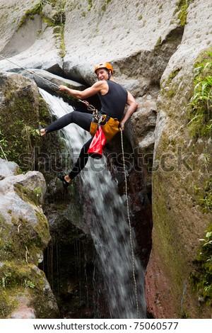 Canyoning on Pucayacu river canyon near Banos, Ecuador
