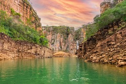 Canyons of Furnas at Capitólio MG, Brazil. Beautiful landscape of canyons of sedimentary rocks, green water lagoon on a colorful sunset. Brazilian tourist destination of Minas Gerais state.