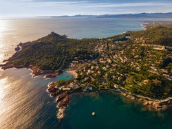 Cap le Dramont, Agay Bay, Anthéor, la Baumette and Saint Raphael scenic and panoramic Aerial view at sunset in the French Riviera, Côte d'Azur, France
