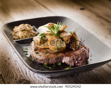 cap mushroom over grilled tenderloin and mustard sauce