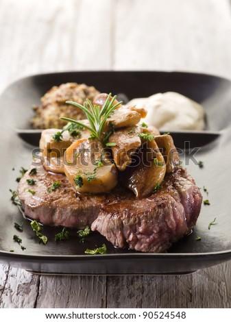 cap mushroom over grilled tenderloin and mustard sauce