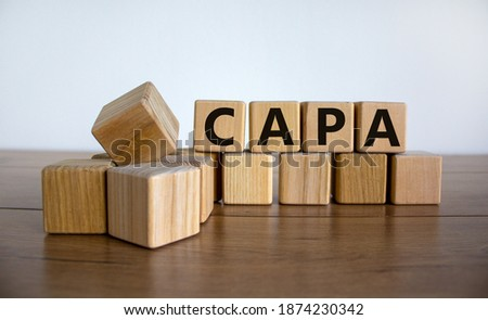 CAPA symbol. Concept word 'CAPA, corrective and preventive actions' on wooden cubes on a beautiful wooden table, white background. Business and CAPA concept. Copy space. Stock fotó ©
