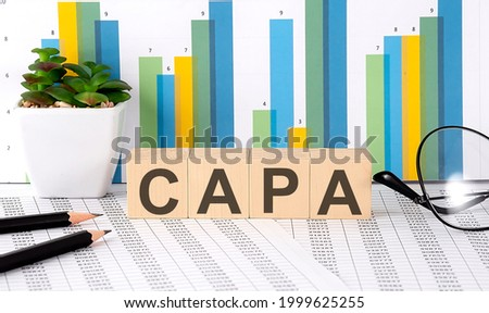 CAPA word written on wood block with chart, glasses and pencils Stock fotó ©