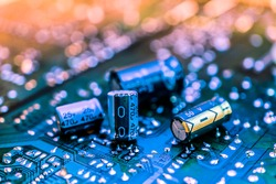 capacitor resistor on circuit board bule background, electronics, component, connector, microchip, technology,
