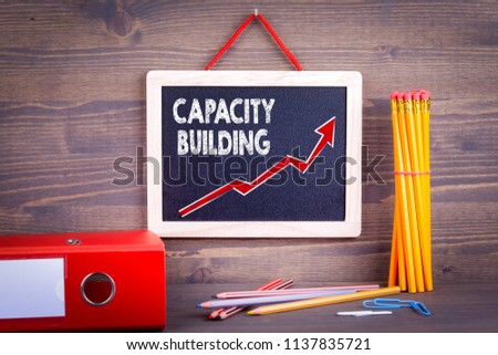 Capacity Building. Business success concept. Chalkboard on a wooden background