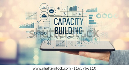 Capacity building with man holding a tablet computer