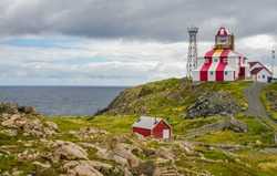Cape Bonavista Lightstation, Newfoundland, Canada.  Lighthouse station LL 449 at end of the cape on the Atlantic Ocean, Navigational aid to ships.  Beacon on a rocky shoreline at the end of the cape.