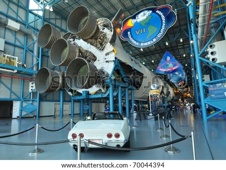 CAPE CANAVERAL, FL- DEC 28: A classic white Corvette and Saturn V rocket displayed in the Apollo/Saturn V Center, at the Kennedy Space Center, NASA in Florida on December 28, 2010.