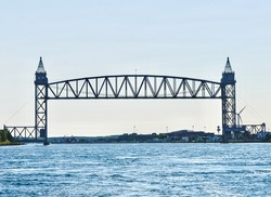 Cape Cod Canal Railroad Bridge, a vertical lift bridge in Bourne, Massachusetts near Buzzards Bay. Constructed in 1935 as part of the WPA to put Americans back to work during the Great Depression.