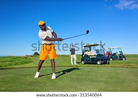 CAPE KIDNAPPERS GOLF CLUB, NEW ZEALAND - 02 FEBRUARY 2015: Golf player is practicing on the golf field. Cape Kidnappers golf court. New Zealand.
