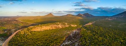 Cape Le Grand National Park in Western Australia - Aerial panorama of some of the granite peaks, hills and bush fire effected area in the national park near the beach camp site near a granite bluff.
