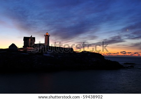 Cape Neddick lighthouse in Coastal maine in pre dawn light