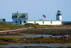 Cape Porpoise (Goat Island) lighthouse during low tide on a sunny late afternoon in Maine. It was used as a security station for President George Bush Sr.
