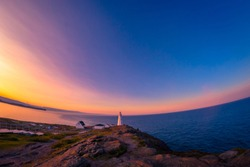 Cape Spears Lighthouse, Newfoundland, Canada. This picture was shot during sunrise in summer season using fisheye lens.