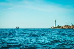 Cape Tarkhankut in summer in sunny weather. lighthouse, sunken ship. Crimea, Russia. tourism, mountains, sea.