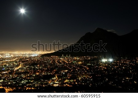 Cape Town city at night with moon in the sky