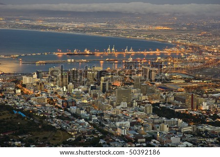 Cape Town city lights with the harbor at dusk - stock photo