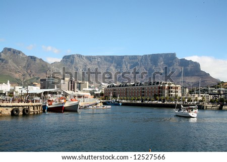 Cape Town Harbour overlooked by Table Mountain (South Africa) #12527566