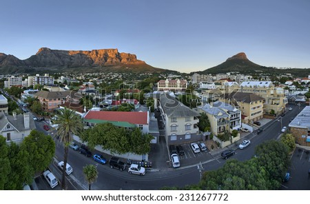 Cape Town's city suburb, known as 'Gardens' in the heart of the CBD, as the sun rises early on a summers morning. Table Mountain, Signal Hill and Lions Head peaks in the background. #231267772