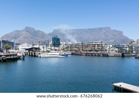 Cape Town, South Africa - March 02, 2017: Cape Town Harbour with Table Mountain in background #676268062