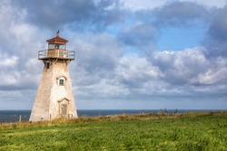 Cape Tryon Lighthouse, Northwest coast of Prince Edward Island, Canada. An historic wooden automated lighthouse sitting above the Gilf of St Lawrence.