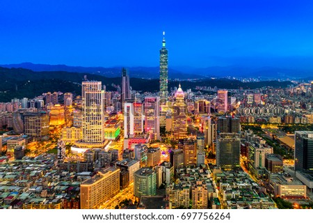 Capital city of Taiwan with view of prominent Taipei 101 Tower and busy street in Xinyi Financial District  #697756264