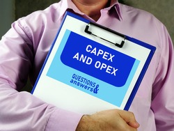 capital expenditure CAPEX AND OPEX operational expenditure text in search bar. Businessman looking at cellphone.