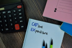 Capital Expenditure write on a book isolated on office desk.