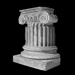 Capital of the ancient Greek Ionic order isolated over black background