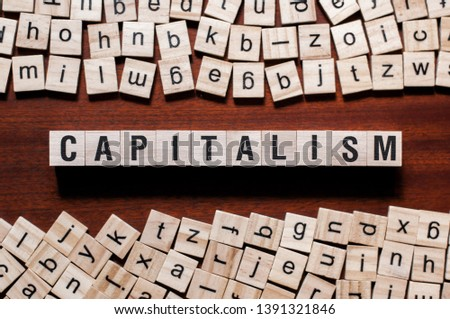 Capitalism word concept on cubes