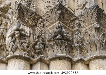 capitals with devils on a pillar of the church of chatellerault in