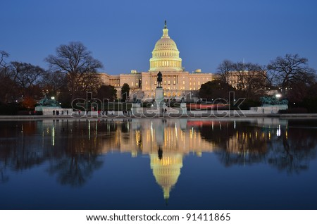 Capitol Building and mirror reflection on pond  in sunrise, Washington D.C. United States