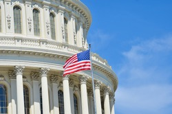 Capitol Building dome detail and waving American flag - Washington DC United States