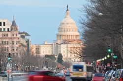 Capitol building from Pennsylvania Avenue with car traffic foreground - Washington DC United States