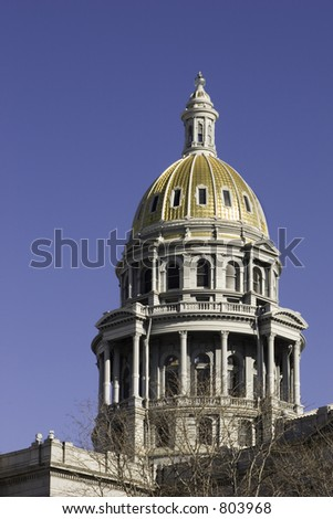Capitol building in downtown Denver Colorado with gold crown.