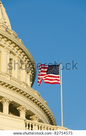 Capitol building in Washington DC USA - Close-up to dome and US flag