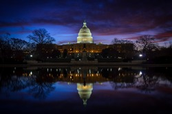 Capitol Building with mirror reflection in water - Washington DC