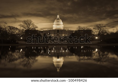 Capitol Building with mirror reflection in water - Washington DC - Sepia - stock photo