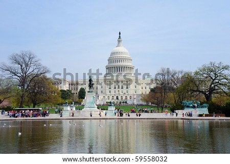 Capitol Building with reflection in lake in Washington DC - stock photo