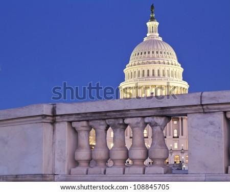 Capitol dome behind the fence  at dusk - Washington, DC, USA